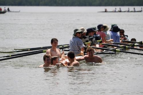 BIR Family - Varsity boys give the girls a tow to shore